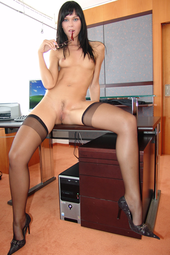 office girl in stockings and glasses
